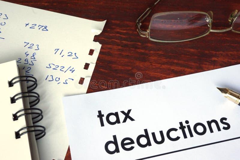 Deduções fiscais escritas em um papel foto de stock royalty free