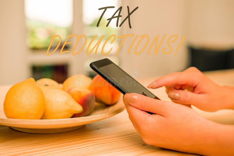 Deducciones fiscales de la escritura del texto de la escritura Concepto que significa la renta de la reducci?n que puede ser grav fotos de archivo libres de regalías