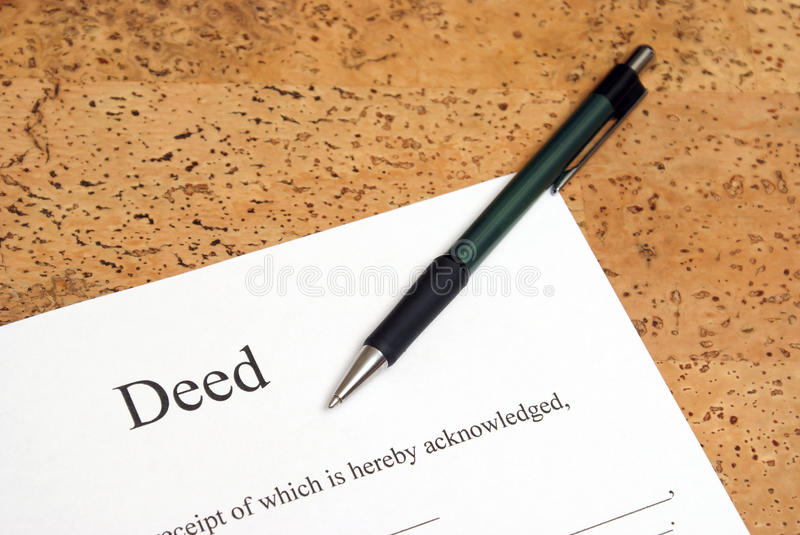 Deed. A closeup shot of deed forms ready for signing royalty free stock image