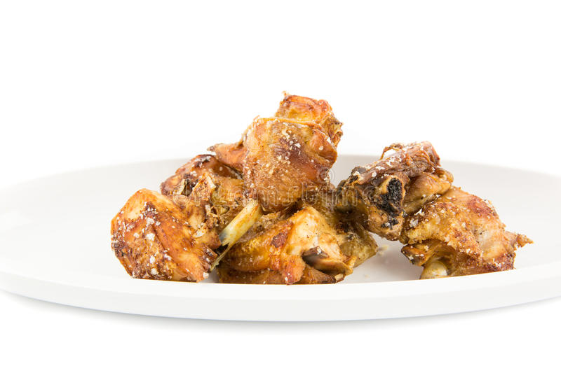 Deed fried chicken. Season with rock salt stock photography