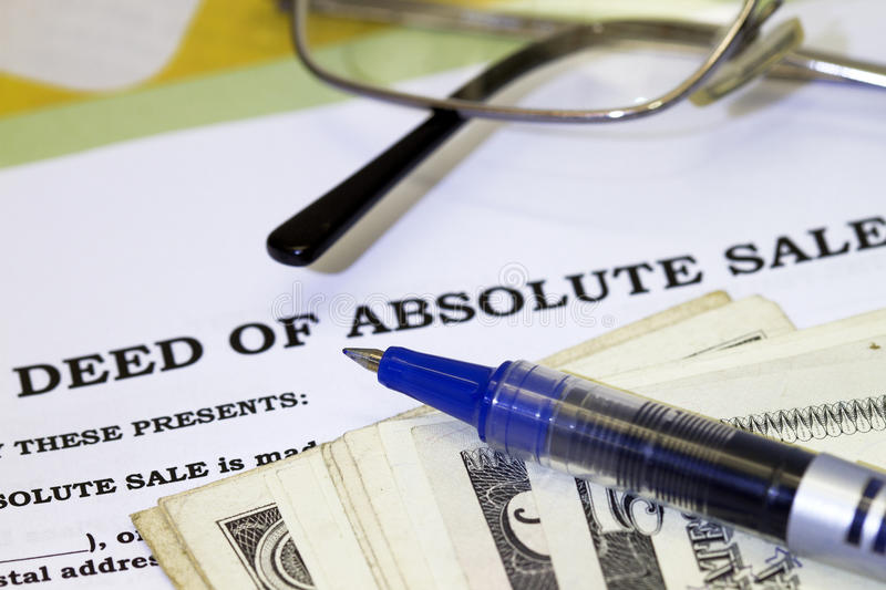 Deed of sale. With dollars and pen royalty free stock images