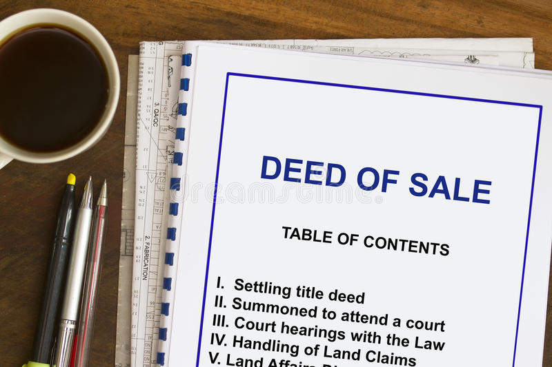 Deed of sale. Concept- lecture notes on the purchasing of land stock image