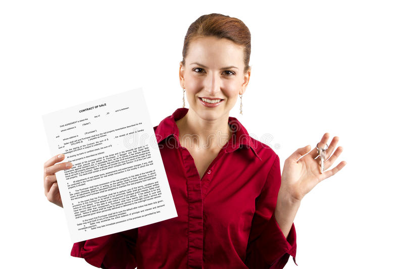 Deed Of Sale. Woman holding keys and a deed of sale contract royalty free stock image
