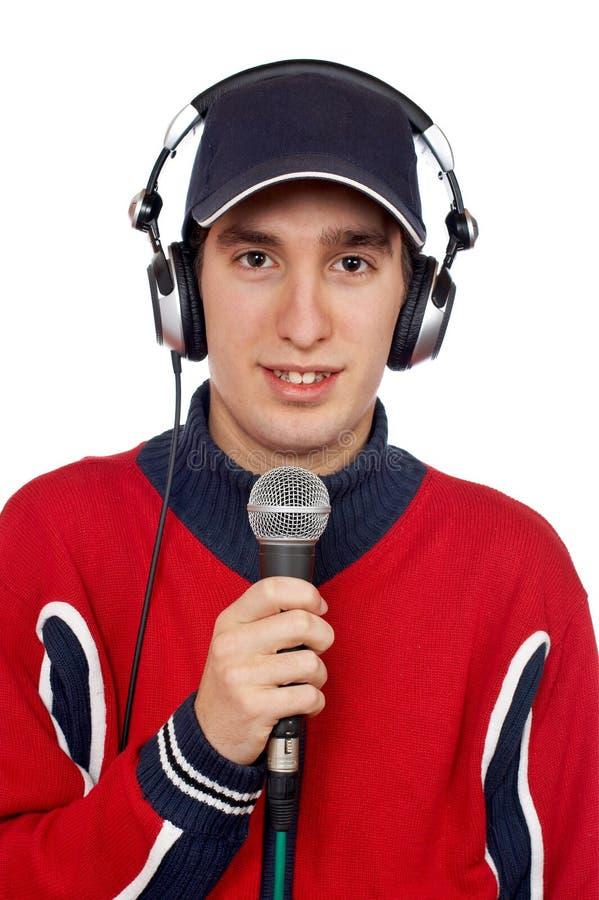 Deejay met hoofdtelefoons en microfoon stock afbeeldingen
