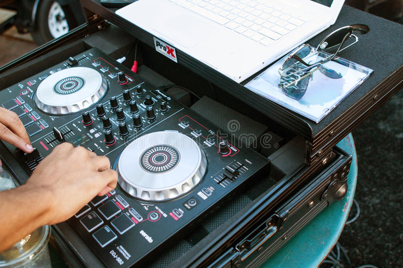 Deejay Turns Knobs On Sound Equipment At Hip Hop Festival. Atlanta, GA, USA - October 8, 2016: A deejay adjusts the knobs on sophisticated sound equipment to stock photography