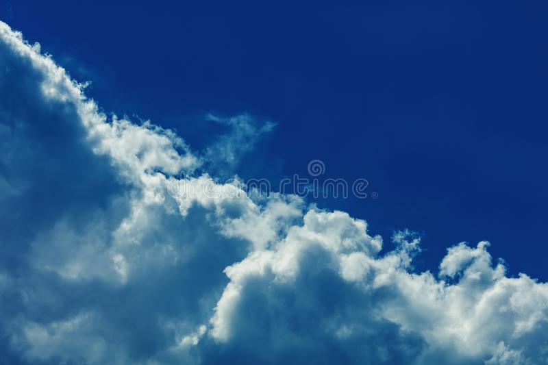 Sky with clouds. Deep blue bright sky with clouds background royalty free stock images