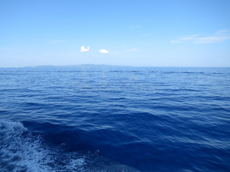 Deep blue horizon. Deep blue sea waves horizon nice weather hot summer lovely time stock image