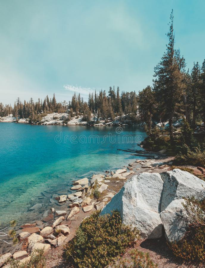 Deep Blue Isolated Crystal Lake in Mammoth, California. Isolated Crystal Lake in Mammoth Lakes, California, USA with deep blue water and green trees royalty free stock photos