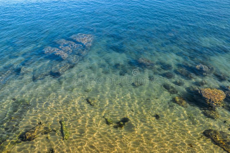 Deep blue lake with clean fresh water royalty free stock photo