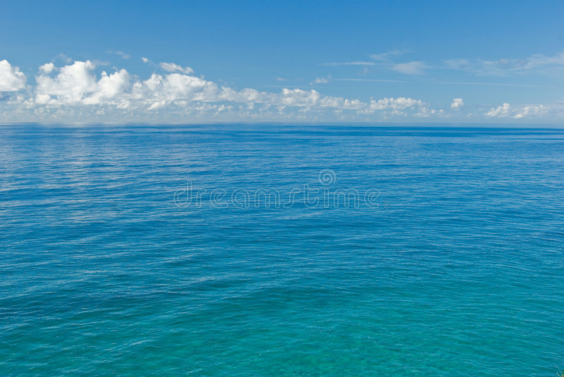 The deep blue sea. The flat and calm deep blue tropical ocean royalty free stock image