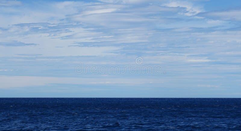 Deep blue sea and blue sky with clouds Sado island Niigata stock photos