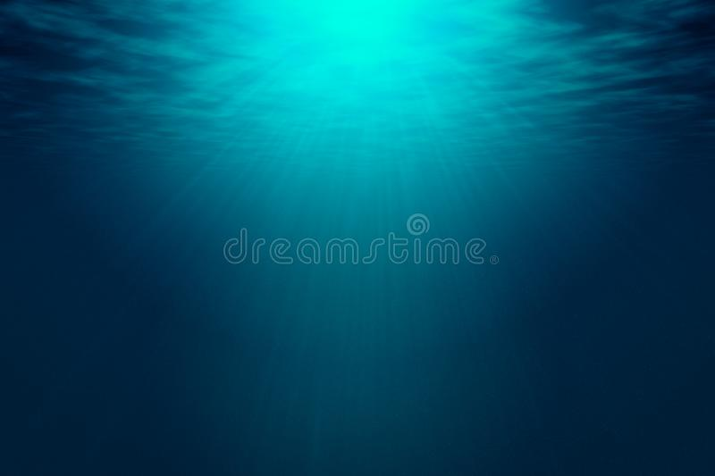 Deep blue sea with rays of sunlight, ocean surface seen from underwater. Background texture with copy space for text or product display stock photos