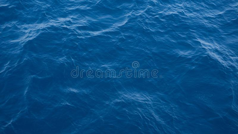 A deep blue sea water texture view from top stock images