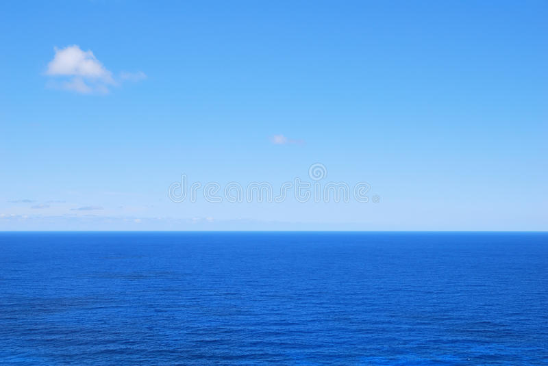 Deep blue sea waters and clear sky. Background stock photography