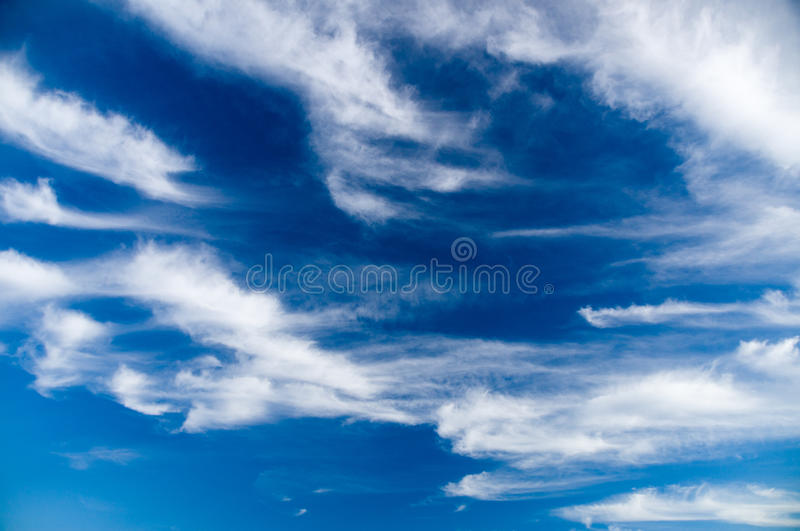 Deep blue sky with picturesque stratus clouds. Natural background royalty free stock photos