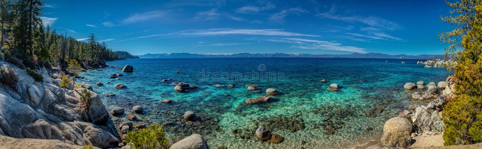 Deep Blue and Turquoise Water at Lake Tahoe Panorama. Unique boulders and colorful blue and turquoise water near Chimney Beach, Lake Tahoe, Carson City, Nevada stock photo