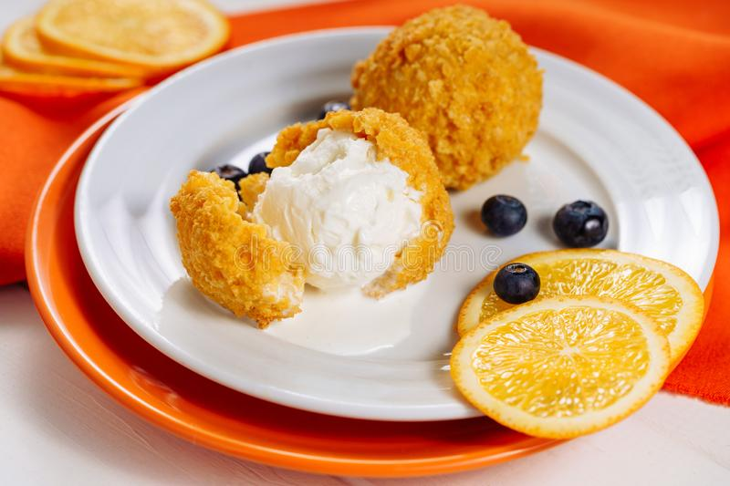 Deep Breaded Fried Icecream Ball Dessert Close-up. Sweet Asia Catering Scoop Crispy Soft Ice Cream Food. Vanilla Delicious Cuisine Restaurant Meal Serving Side stock images