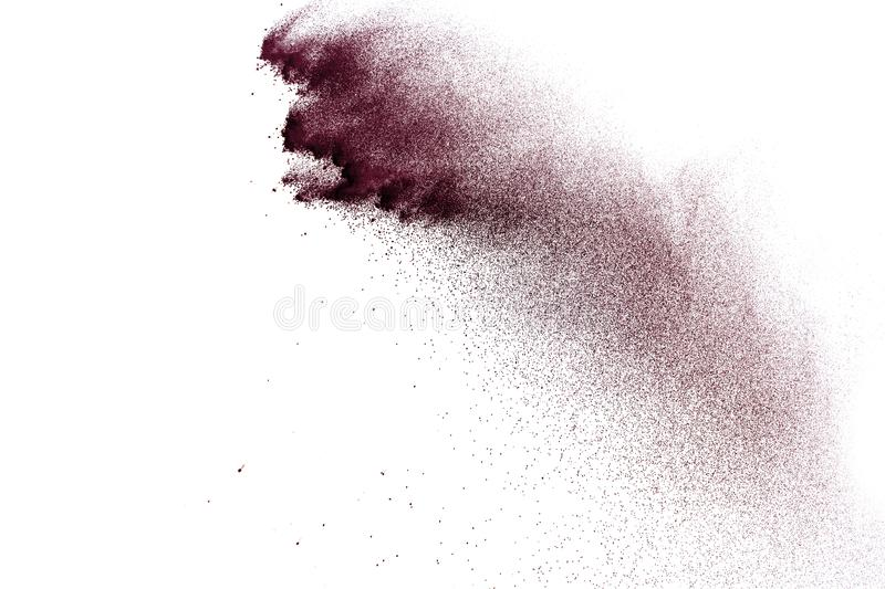 Deep brown color particles splatter on white background. Brown dust splash on white background stock photography