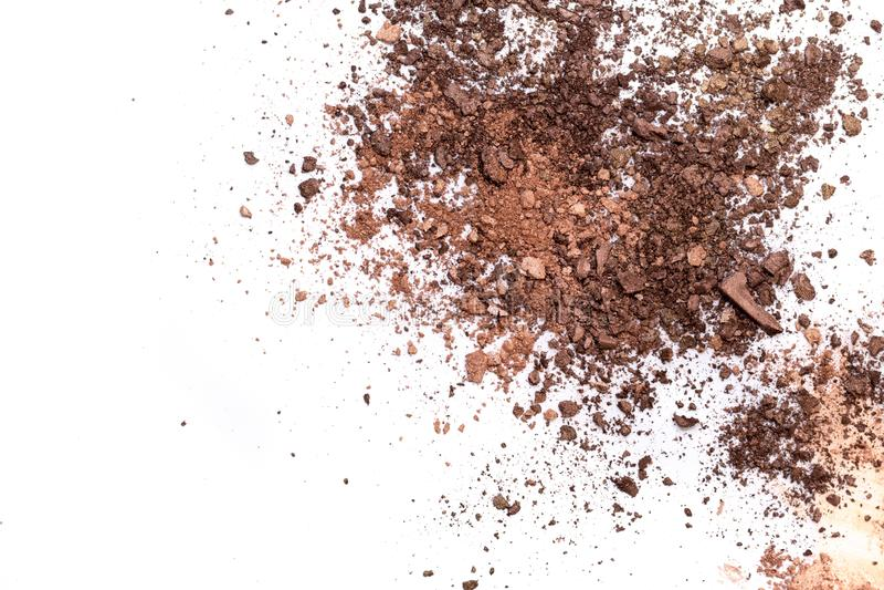 Deep brown crumbled eye shadow isolated on white background.Broken brown eyeshadow palette isolated on a white background royalty free stock image