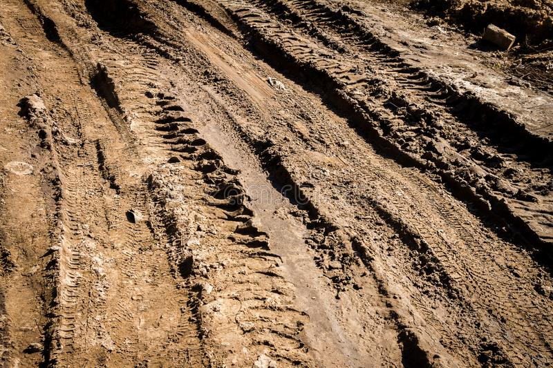 Deep car rut on a dirt road. Empty countryside dirt wet road stock photography