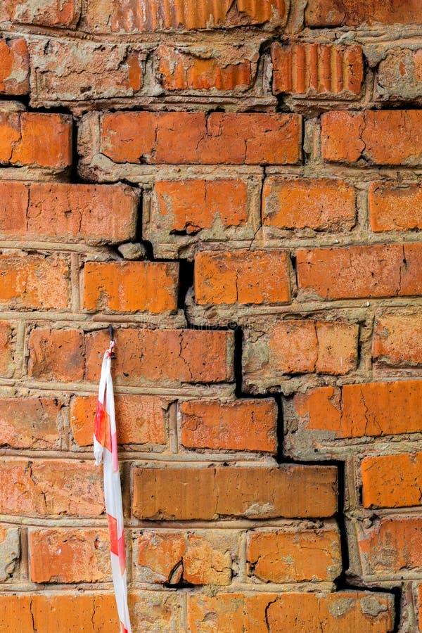 Deep cracked orange brick wall closeup texture and background stock photo