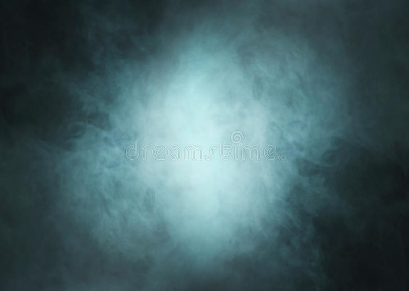 Deep cyan smoke background with light in center. Deep cyan smoke background with light in the center