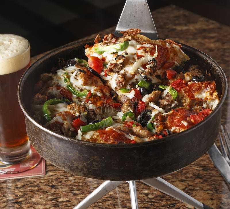 Deep Dish Pizza and Beer. Deep Dish Combination Pizza and Beer stock photos