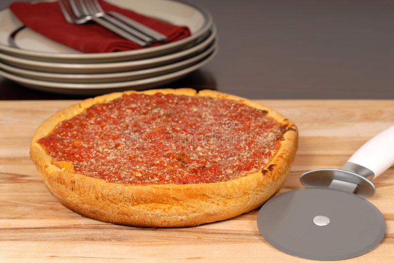 Download Deep Dish Pizza On A Cutting Board Stock Image - Image: 1946983