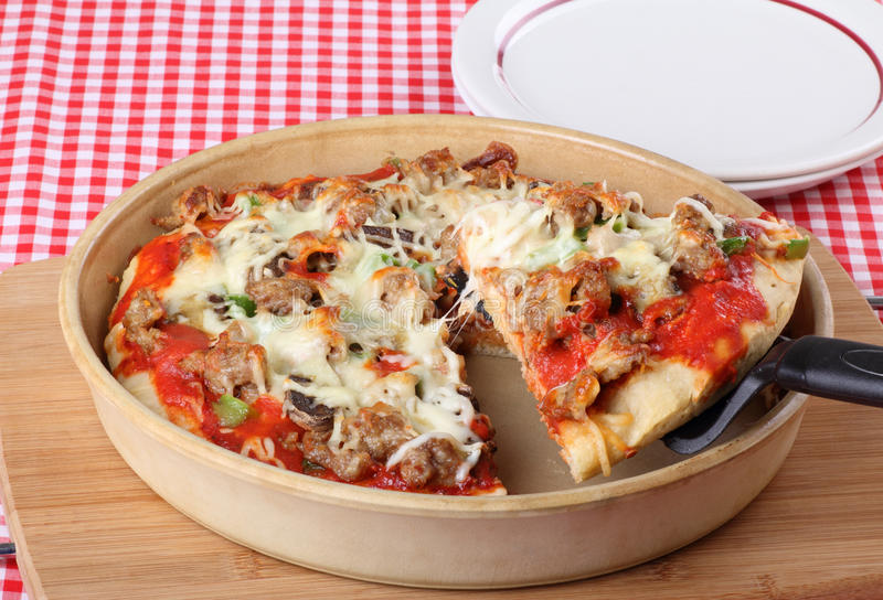 Deep Dish Pizza Slice stock image