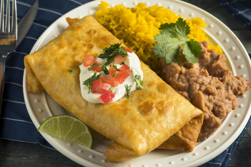 Deep Fried Beef Chimichanga Burrito. With Rice and Beans stock image