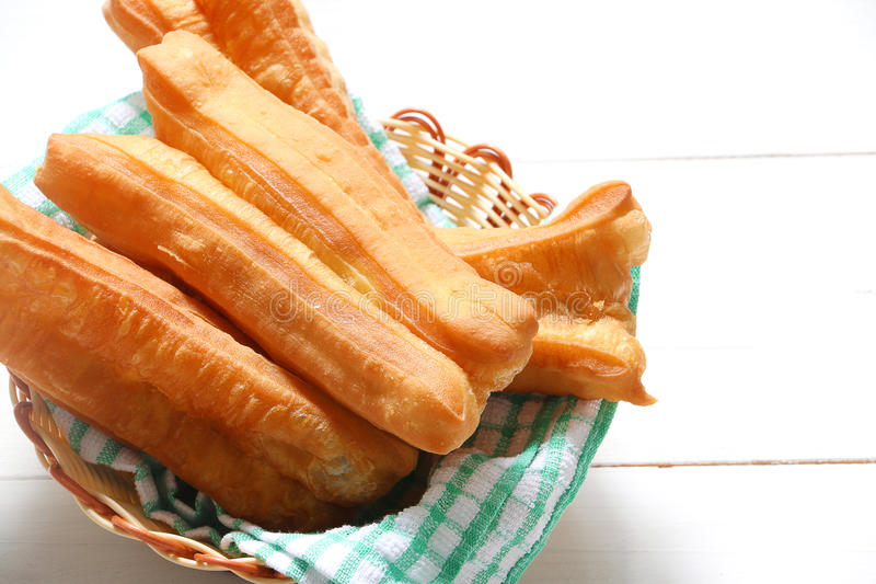 Deep fried bread stick-You Tiao. Chinese traditional food, deep fried bread stick normally eaten with rice porridge or spread with butter and coconut jam royalty free stock photography