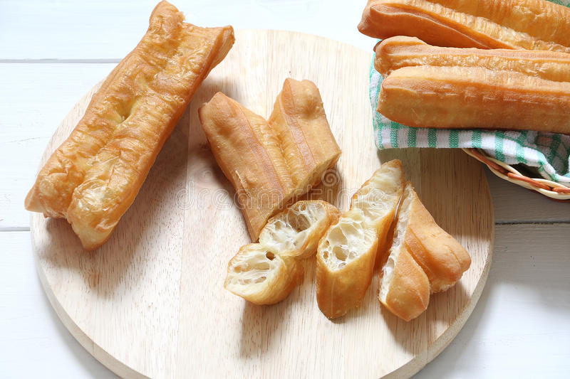 Deep fried bread stick-You Tiao. Chinese traditional food, deep fried bread stick normally eaten with rice porridge or spread with butter and coconut jam royalty free stock images