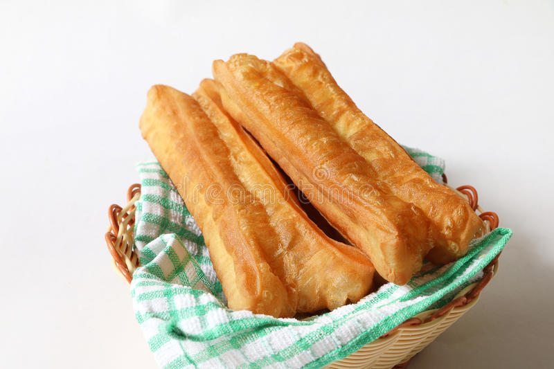 Deep fried bread stick-You Tiao. Chinese traditional food, deep fried bread stick normally eaten with rice porridge or spread with butter and coconut jam stock images