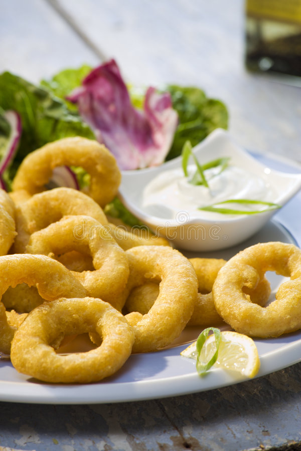 Deep-fried breaded squid close up stock photos