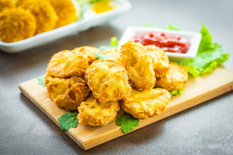 Deep fried chicken meat call nugget with tomato or ketchup sauce stock photo