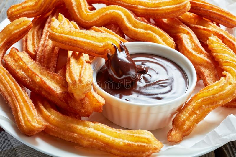 Deep fried churros served with chocolate dipping stock photography