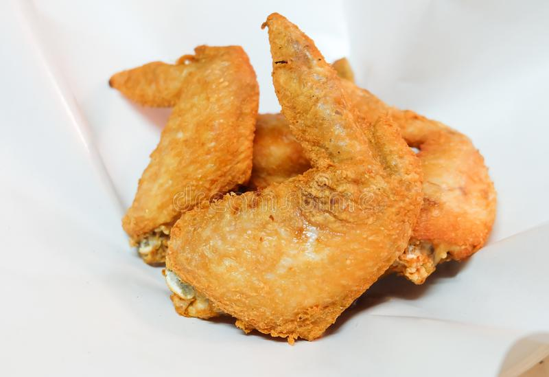 Deep fried crispy chicken wings with fish sauce stock images