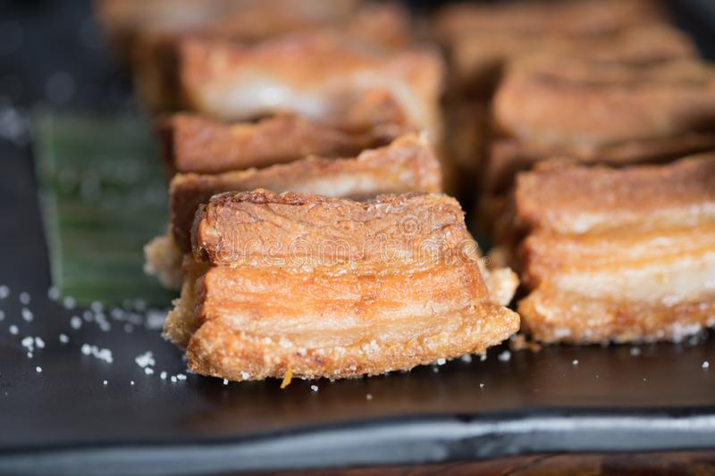 Deep fried crispy pork belly with salted royalty free stock photography