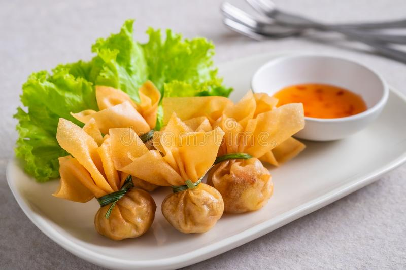 Deep fried crispy wonton, money bag or golden bag Toong Thong served with sweet chilli sauce, Thai food culture royalty free stock photos