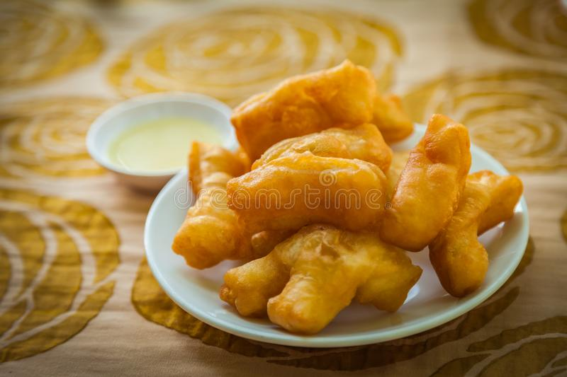 Deep-fried dough stick. With cream for breakfast, chinese style royalty free stock image