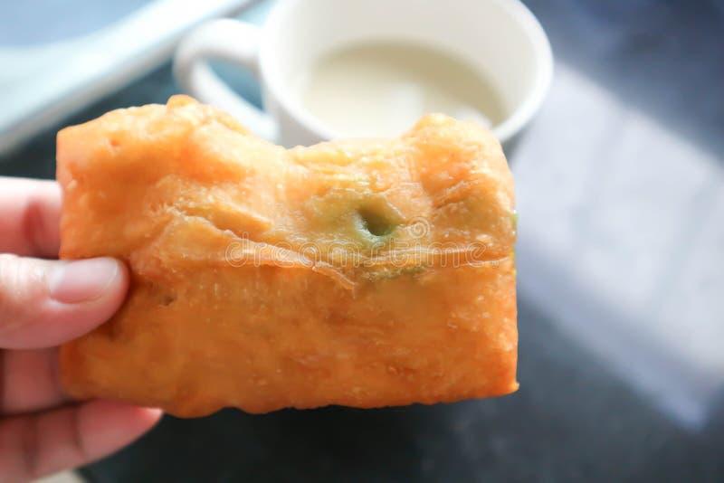 Deep-fried dough stick. With custard stuffed royalty free stock image