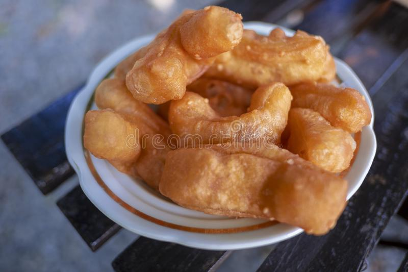 Deep-fried dough stick. Eaten with morning coffee stock images