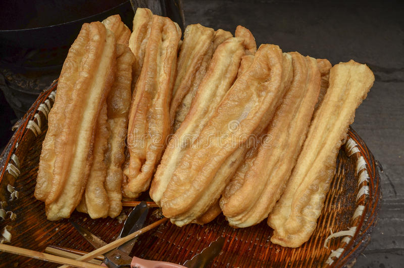 Deep-fried dough stick. In the market stock images