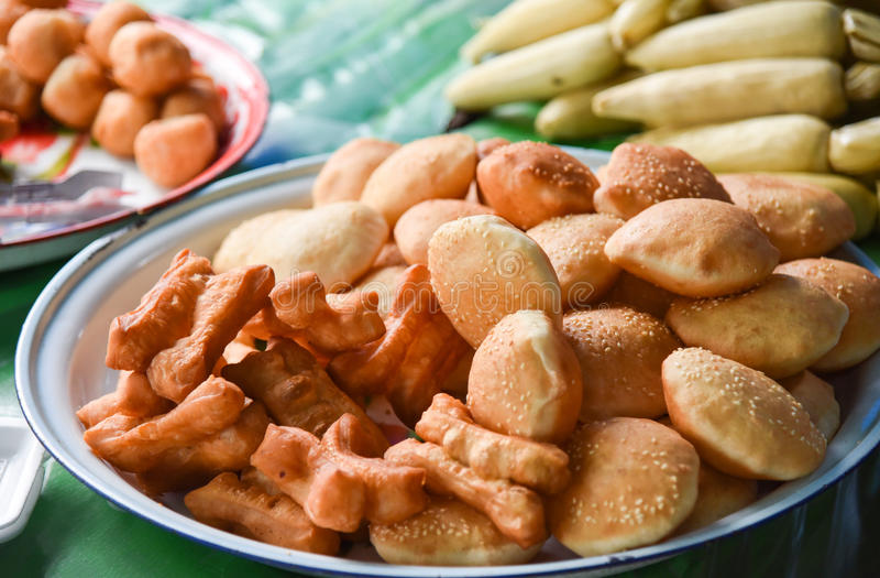 Deep-fried dough stick or Thai called Patongko. Famous street food in Thailand stock photography