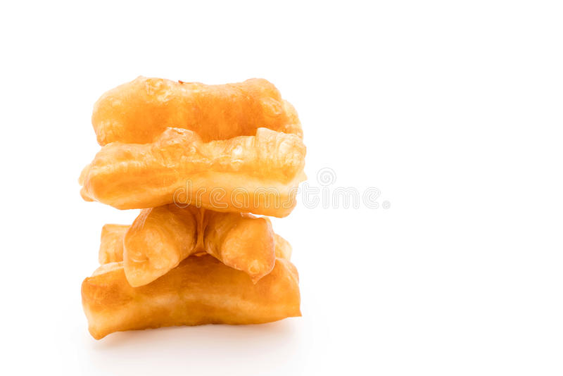 Deep-fried dough stick. On white background royalty free stock images