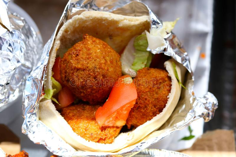 Deep fried Falafel balls in a wrap royalty free stock photography