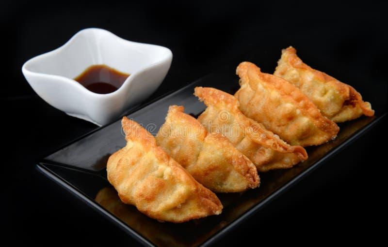 Deep fried gyoza crispy and golden colour. stock photos