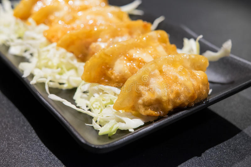 Deep Fried Gyuza. On black table royalty free stock images