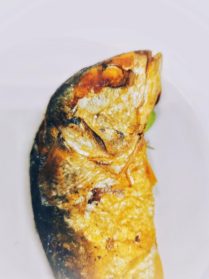 Deep fried mackerel Fish on the white Easter VEGA Food Meal for Thai people in Bangkok royalty free stock images