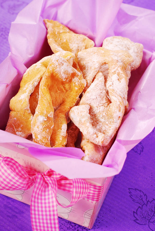 Deep-fried pastries with icing sugar royalty free stock image